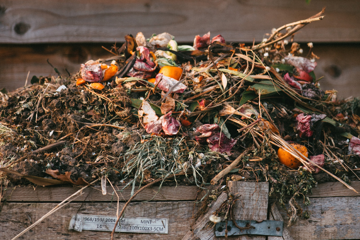 pile of organic floral compost in rustic wooden crate